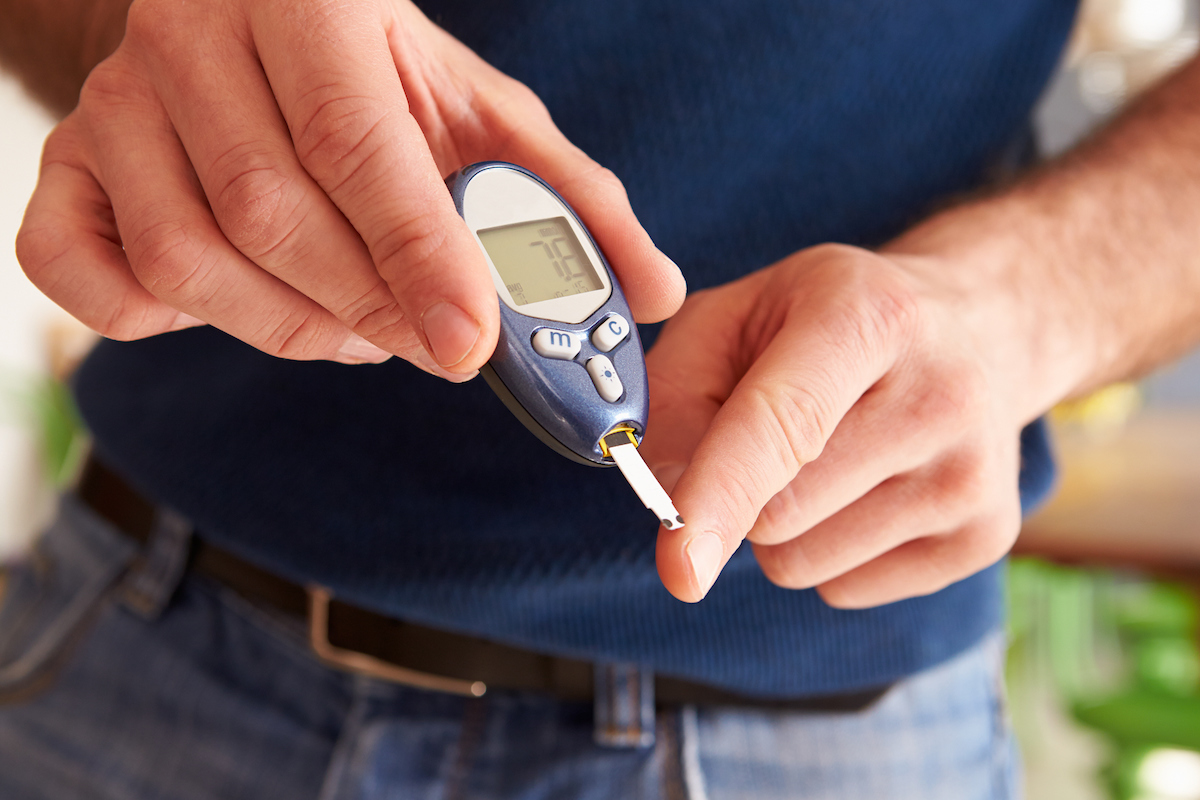 Male Diabetic Checking Blood SugarLevels