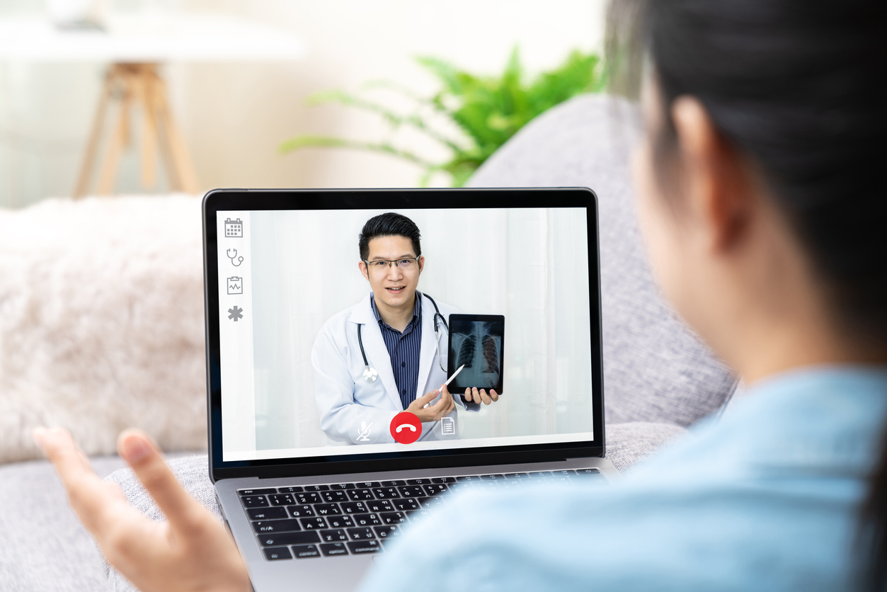 Asian chinese doctor video conference call online talking for follow up remotely with medical coronavirus result at home. Online healthcare digital technology service, counselor and internet support.